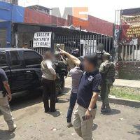Aseguran tres inmuebles, autopartes, camionetas y tractocamiones en Uruapan, Michoacán