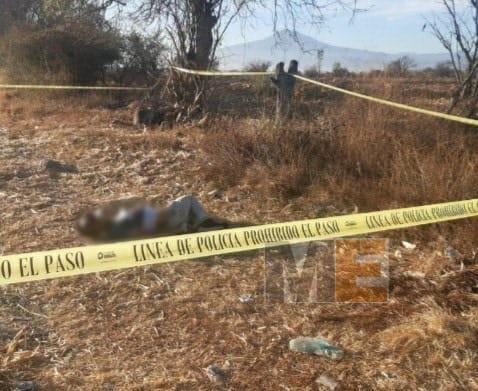 Maniatado y con impactos de bala localizan cadáver en Tangancícuaro